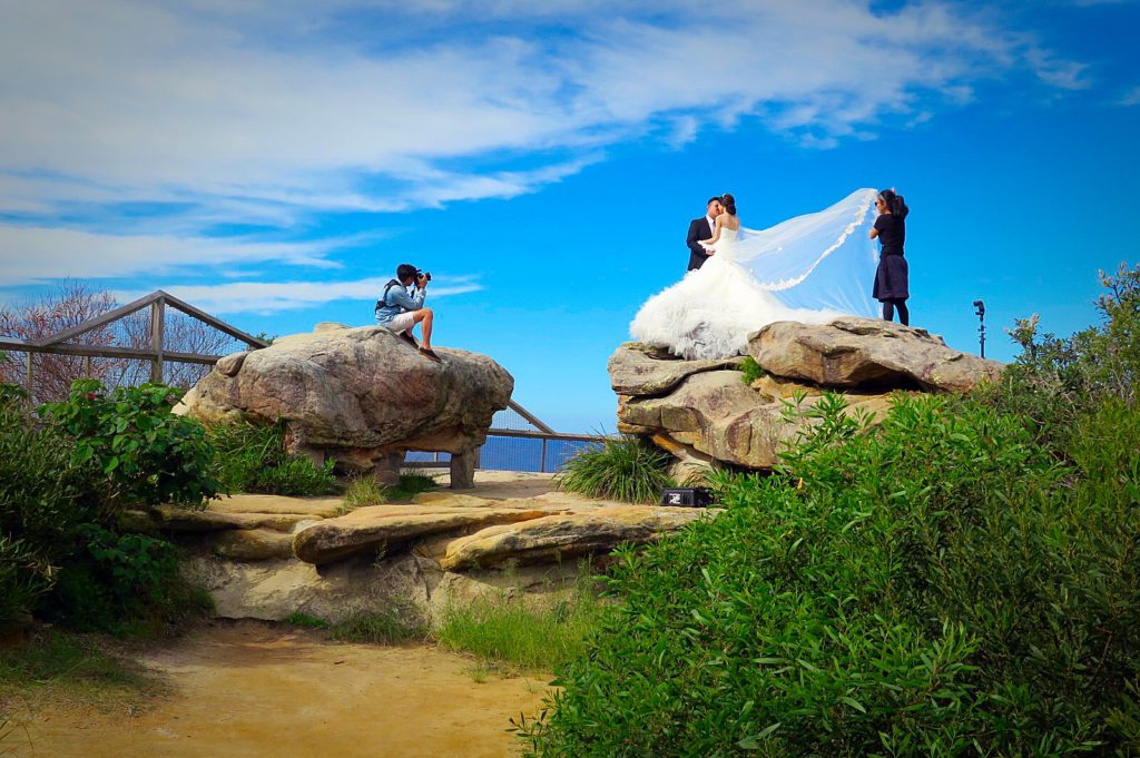 Bride overlooks the ocean
